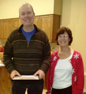 Pictured receiving his award is Pete with owner Liz Kalina at our holiday gathering.